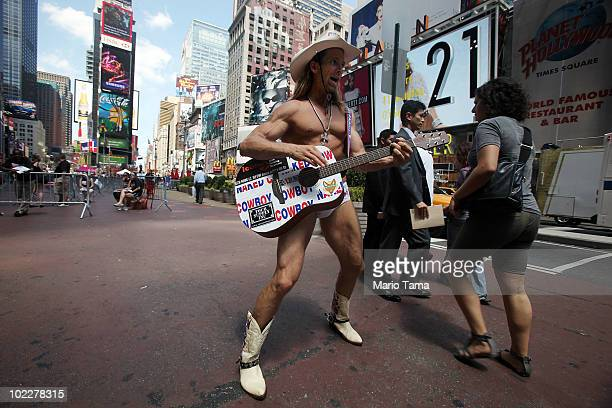 The Naked Cowboy plays in Times Square on June 21 2010 in New York City Accused Times Square bomber Faisal Shahzad is slated to be arraigned this...