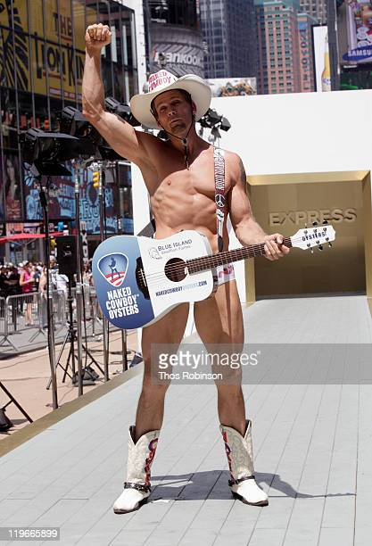 The Naked Cowboy walks the runway as Express breaks Guinness World Record for most people to walk in a runway show in Times Square on July 23 2011 in...