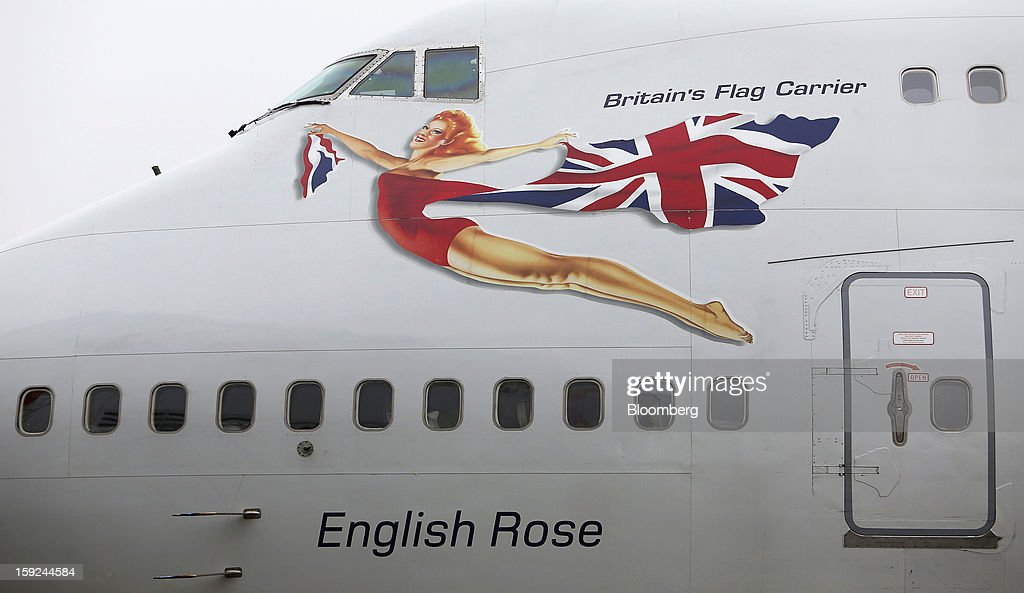 The name 'English Rose' sits beneath the cabin windows of a Boeing 747-400 aircraft, operated by Virgin Atlantic, at Gatwick airport in Crawley, U.K., on Thursday, Jan. 10, 2013. Gatwick, acquired by Global Infrastructure Partners Ltd. in 2009 after regulators sought a breakup of BAA Ltd., owner of the larger Heathrow hub, is 30 miles (48 kilometers) south of London and serves about 200 destinations, more than any other U.K. airport, according to flight schedule data provider OAG. Photographer: Chris Ratcliffe/Bloomberg via Getty Images