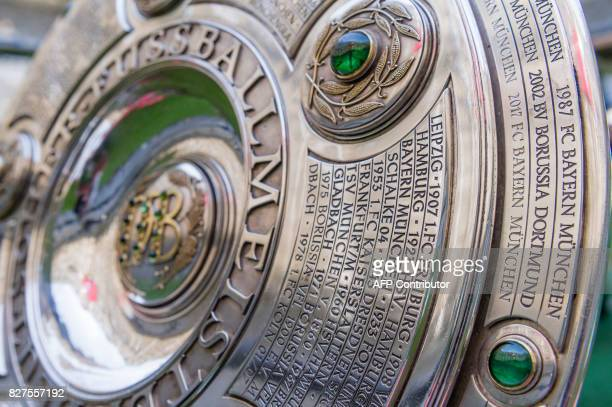 The name of Bayern Munich is engraved on the champions trophy seen during the team photo session of FC Bayern Munich in the southern German city of...