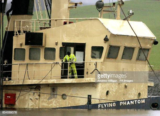 The name of The Flying Phantom tug becomes visible as the barge GPS Atlas continues its salvage operation on the river ClydeThe Flying Phantom tug...