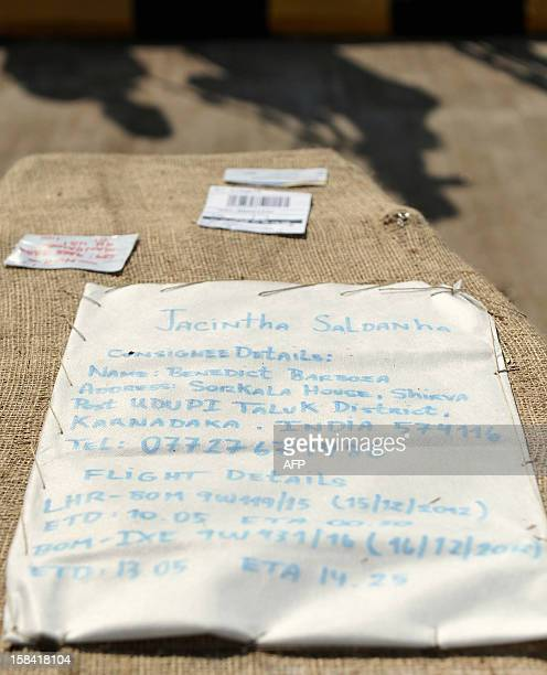 The name tag Indiaborn nurse Jacintha Saldanha is attached to her coffin at the Bajpe Airport in Mangalore on December 16 2012 The body of Saldanha...