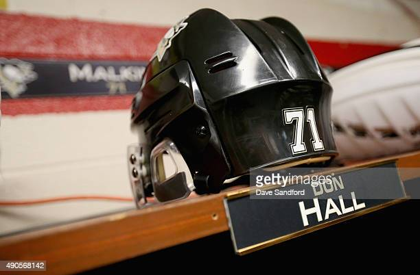 The nameplate of Don Hall former hockey player for the Johnstown Jets is seen on the stall of Evgeni Malkin of the Pittsburgh Penguins in the locker...