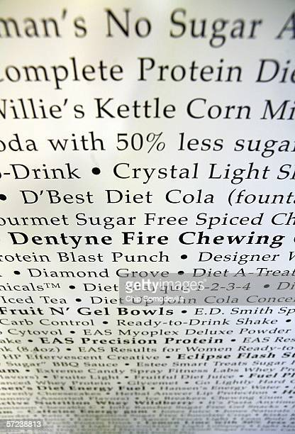 The names of hundredes of consumer products that use sucralose or Splenda are listed on posters during a press conference at the National Press Club...