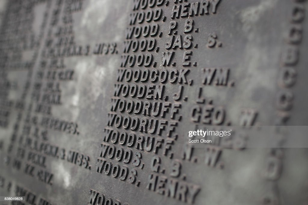 The names of more than 4,000 Confederate prisoners of war who died in captivity at Camp Douglas are listed at the base of Confederate Mound monument on August 23, 2017 in Chicago, Illinois. The monument, which is maintained by the National Park Service, is located inside the private Oak Woods Cemetery on Chicago's Southside. Cities around the country are debating what to do with Confederate monuments following recent protests and calls for their removal.