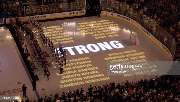 The names of some of the 58 people killed at the Route 91 Harvest country music festival are projected on the ice as police fire and medical...