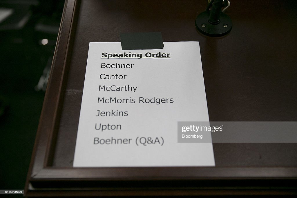 The names of speakers including House Speaker John Boehner, a Republican from Ohio and House Majority Leader Eric Cantor, a Republican from Virginia, are listed in order on a piece of paper prior to a news conference in Washington, D.C., U.S., on Thursday, Sept. 26, 2013. John Boehner's choice -- between keeping the government running and continuing to fight the nation's three-year-old health-care law - has implications for the 2014 congressional elections and, potentially, his future. Photographer: Andrew Harrer/Bloomberg via Getty Images