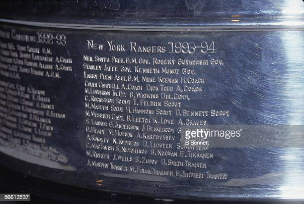 The names of the 199394 champion New York Rangers are engraved on the base of the Stanley Cup trophy mid 1990s