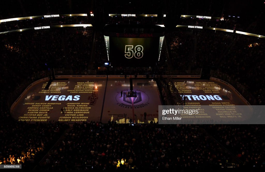 The names of the 58 people killed at the Route 91 Harvest country music festival are projected on the ice before the Vegas Golden Knights' inaugural regular-season home opener against the Arizona Coyotes at T-Mobile Arena on October 10, 2017 in Las Vegas, Nevada. The Golden Knights honored first responders and victims of last week's mass shooting at the game. On October 1, Stephen Paddock killed 58 people and injured more than 450 after he opened fire on a large crowd at the festival. The massacre is one of the deadliest mass shooting events in U.S. history.