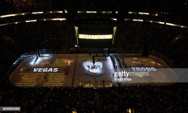The names of the 58 people killed at the Route 91 Harvest country music festival are projected on the ice before the Vegas Golden Knights' inaugural...