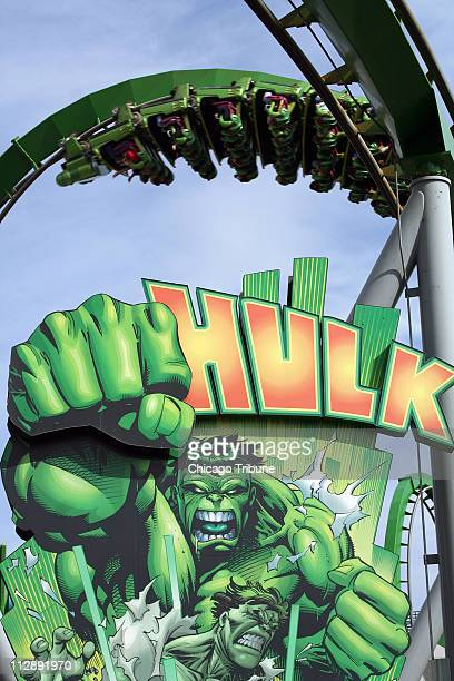 The namesake coaster inverted for the moment roars over the Incredible Hulk at Universal's Islands of Adventure Orlando theme parks where adults as...
