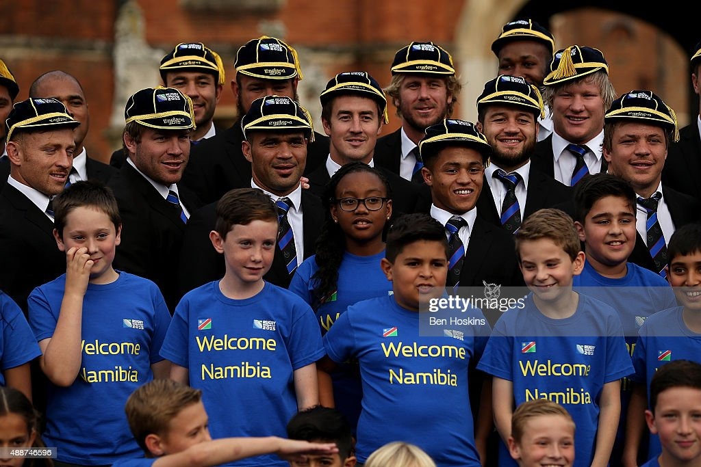 The Namibian team pose for a picture with The Chase Bridge Primary School Choir during the RWC 2015 Welcome Ceremony for Namibia at Hampton Court...