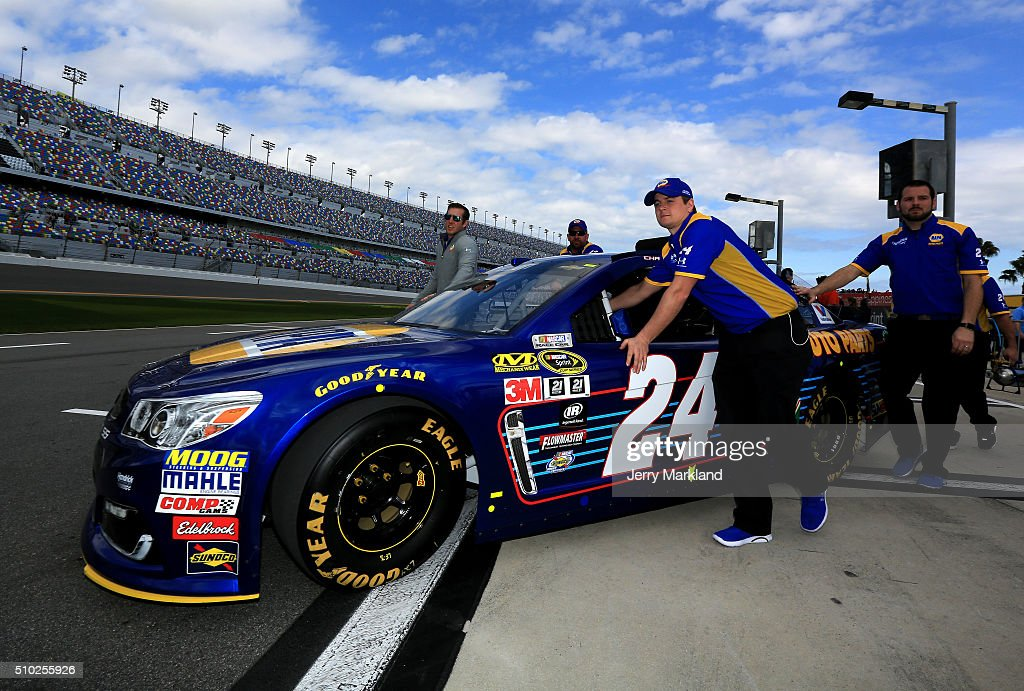 The #24 NAPA Auto Parts Chevrolet, driven by Chase Elliott (not pictured), is pushed by crew members during qualifying for the NASCAR Sprint Cup Series Daytona 500 at Daytona International Speedway on February 14, 2016 in Daytona Beach, Florida.