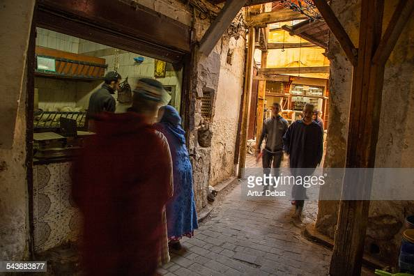 The narrow streets of the Fez Medina with people and market Morocco Africa November 27th of 2013