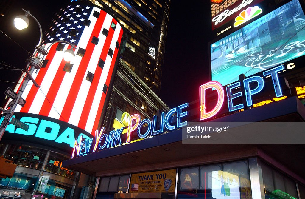 The nasdaq electronic billboard glows with us near the for What to do around times square