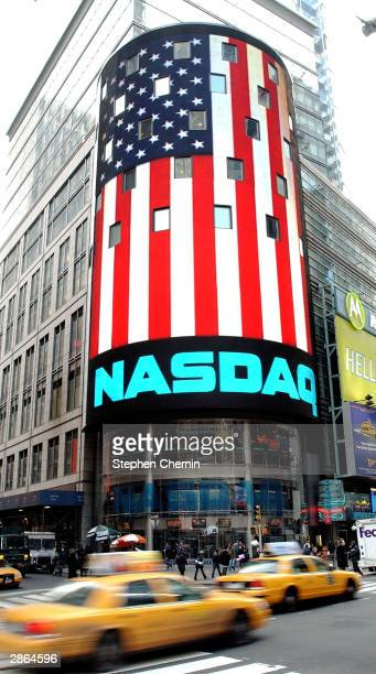 The Nasdaq electronic Times Square billboard displays the US flag January 13 2004 in New York City The Nasdaq announced that six bluechip companies...