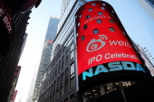 The Nasdaq exchange advertises China's Weibo in Times Square moments before it began trading on the Nasdaq exchange under the ticker symbol WB on...