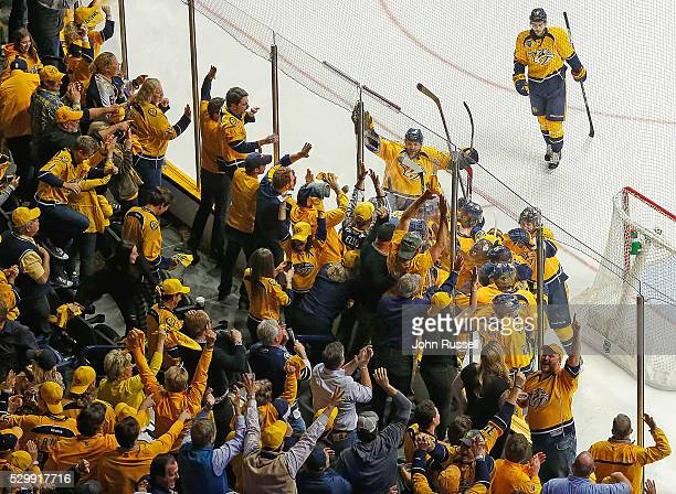 The Nashville Predators and fans celebrate a 43 overtime win against the San Jose Sharks in Game Six of the Western Conference Second Round during...