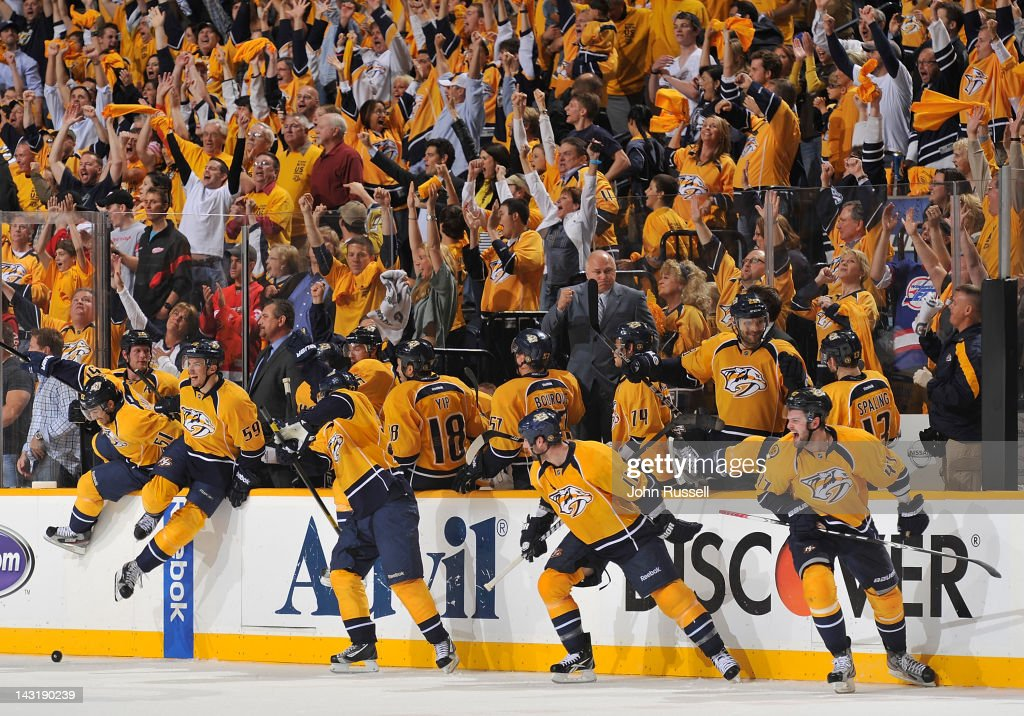 The Nashville Predators bench and fans erupt in celebration as the horn sounds in a 2-1 series clinching win against the Detroit Red Wings in Game Five of the Western Conference Quarterfinals during the 2012 NHL Stanley Cup Playoffs at the Bridgestone Arena on April 20, 2012 in Nashville, Tennessee.