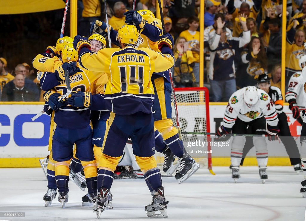 The Nashville Predators celebrate a 4-1 win against the Chicago Blackhawks to take the series in Game Four of the Western Conference First Round during the 2017 NHL Stanley Cup Playoffs at Bridgestone Arena on April 20, 2017 in Nashville, Tennessee.