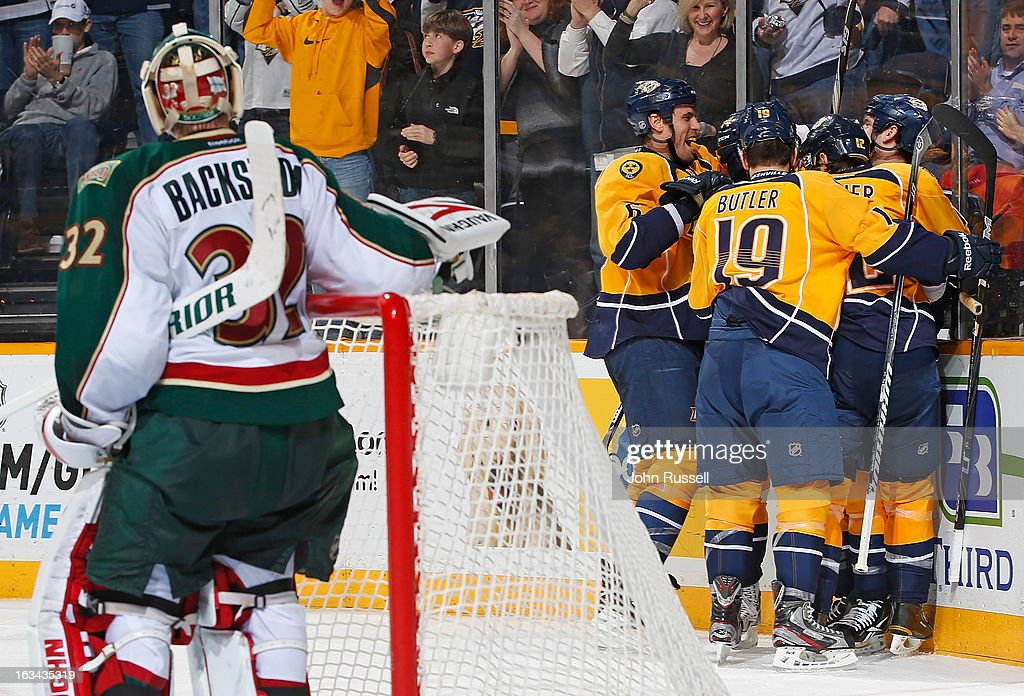 The Nashville Predators celebrate a goal against <a gi-track='captionPersonalityLinkClicked' href=/galleries/search?phrase=Niklas+Backstrom&family=editorial&specificpeople=861018 ng-click='$event.stopPropagation()'>Niklas Backstrom</a> #32 of the Minnesota Wild during an NHL game at the Bridgestone Arena on March 9, 2013 in Nashville, Tennessee.