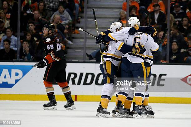 The Nashville Predators celebrate a goal by Paul Gaustad during the first period of a game against the Anaheim Ducks during Game Seven of the Western...