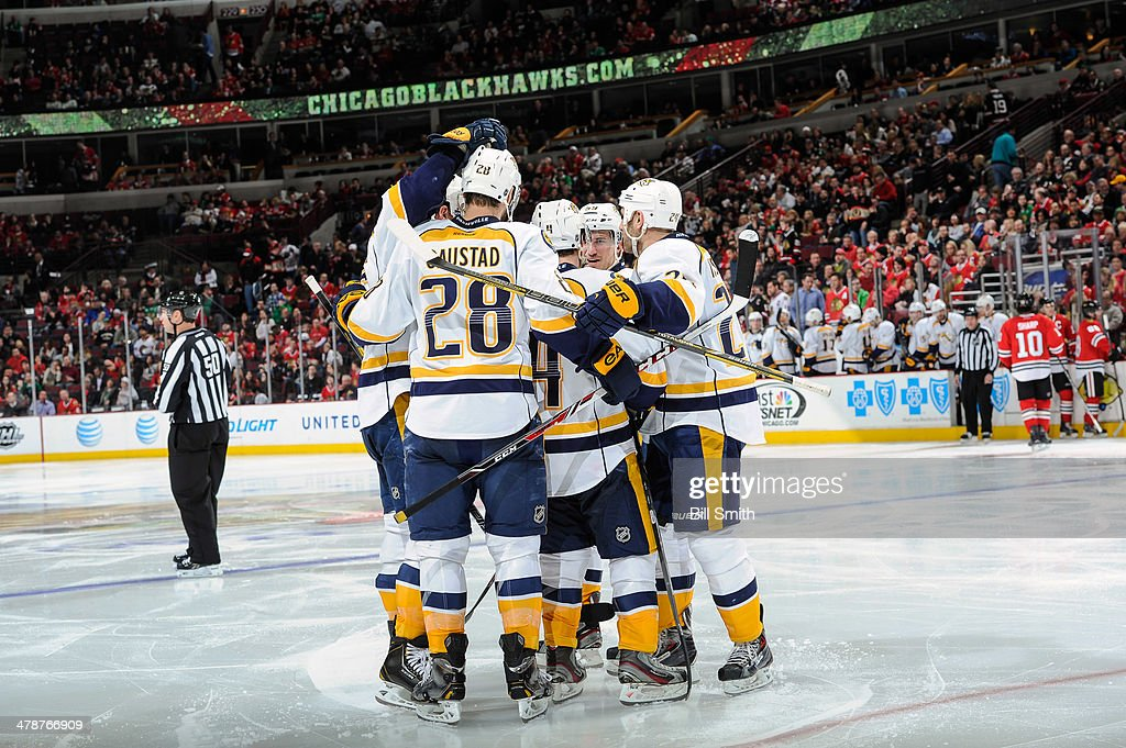 The Nashville Predators celebrate, including <a gi-track='captionPersonalityLinkClicked' href=/galleries/search?phrase=Roman+Josi&family=editorial&specificpeople=4247871 ng-click='$event.stopPropagation()'>Roman Josi</a> #59 (middle), after the Predators scored against the Chicago Blackhawks in the third period during the NHL game on March 14, 2014 at the United Center in Chicago, Illinois.