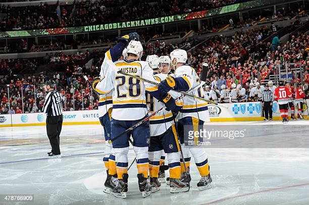 The Nashville Predators celebrate including Roman Josi after the Predators scored against the Chicago Blackhawks in the third period during the NHL...