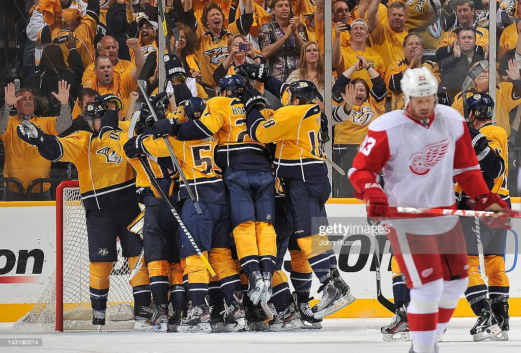 The Nashville Predators celebrate their series clinching win against the Detroit Red Wings in Game Five of the Western Conference Quarterfinals during the 2012 NHL Stanley Cup Playoffs at the Bridgestone Arena on April 20, 2012 in Nashville, Tennessee.