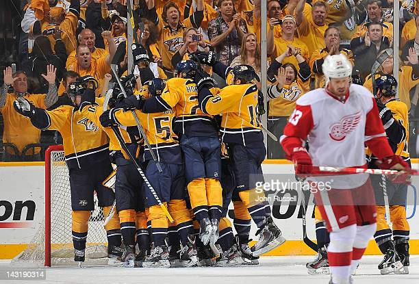 The Nashville Predators celebrate their series clinching win against the Detroit Red Wings in Game Five of the Western Conference Quarterfinals...