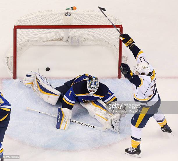 The Nashville Predators' Colin Wilson right reacts after assisting on a goal by James Neal not pictured past St Louis Blues goaltender Brian Elliott...