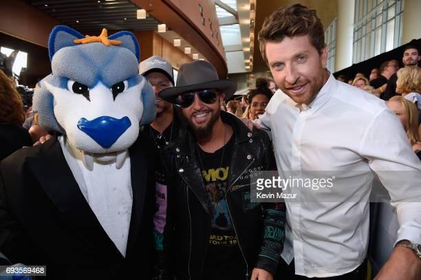 The Nashville Predators mascot Gnash Preston Brust of Locash and Brett Eldredge attend the 2017 CMT Music Awards at the Music City Center on June 7...