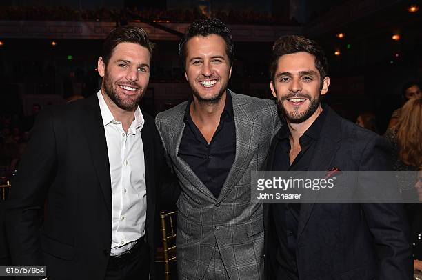 The Nashville Predators' Mike Fisher and honorees Luke Bryan and Thomas Rhett pose for a photo during CMT Artists of the Year 2016 on October 19 2016...