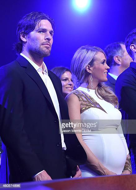 The Nashville Predators' Mike Fisher and recording artist Carrie Underwood attend the 2014 American Country Countdown Awards at Music City Center on...