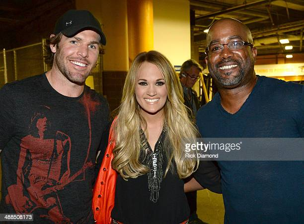 The Nashville Predators' Mike Fisher Carrie Underwood and Darius Rucker attend Keith Urban's Fifth Annual 'We're All 4 The Hall' Benefit Concert at...