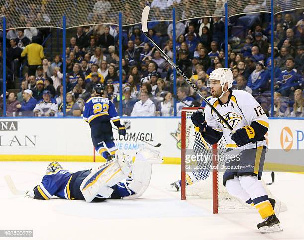 The Nashville Predators' Mike Fisher right reacts after scoring past St Louis Blues goaltender Brian Elliott in secondperiod action on Thursday Jan...