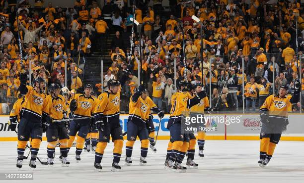 The Nashville Predators raise their sticks to the fans after defeating the Detroit Red Wings in Game One of the Western Conference Quarterfinals...