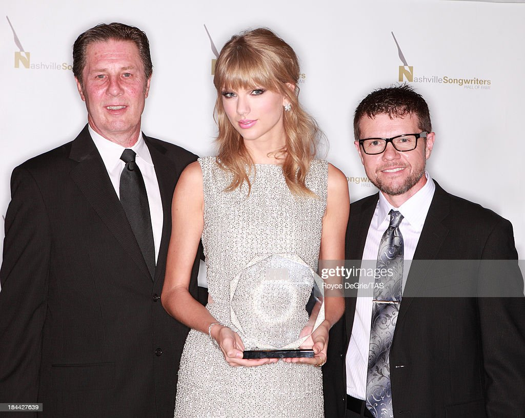 The Nashville Songwriters Association International named seven-time GRAMMY winner <a gi-track='captionPersonalityLinkClicked' href=/galleries/search?phrase=Taylor+Swift&family=editorial&specificpeople=619504 ng-click='$event.stopPropagation()'>Taylor Swift</a> their 2013 Songwriter/Artist of the Year. Swift's 6th time to win the award, she has now won this award more times than any other songwriter/artist, surpassing 5-time winners Vince Gill and Alan Jackson. She remains the youngest artist ever to earn the award. Her album RED reached #1 in 50 countries, and has sold more than 6 million copies. Yesterday, Swift opened the $4 million <a gi-track='captionPersonalityLinkClicked' href=/galleries/search?phrase=Taylor+Swift&family=editorial&specificpeople=619504 ng-click='$event.stopPropagation()'>Taylor Swift</a> Education Center at the Country Music Hall of Fame and Museum. Taylor is joined by NSAI Executive Director Bart Herbison and NSAI Board President Lee Thomas Miller at on October 13, 2013 in Nashville, Tennessee.
