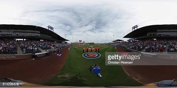 The national anthem is performed before the spring training game between the Kansas City Royals and Chicago Cubs at Sloan Park on March 7 2016 in...