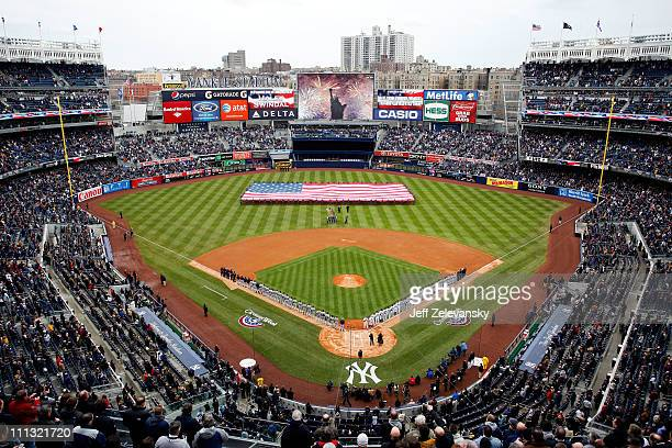 The National Anthem is performed by Haley Swindal as the US Navy Super Hornet flyover takes place before the New York Yankees face the Detroit Tigers...