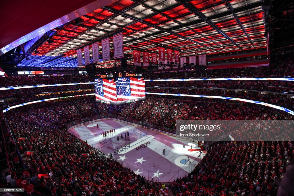 The National Anthem is played prior to the Detroit Red Wings game versus the Minnesota Wild on October 5, 2017, at Little Caesars Arena in Detroit, Michigan.