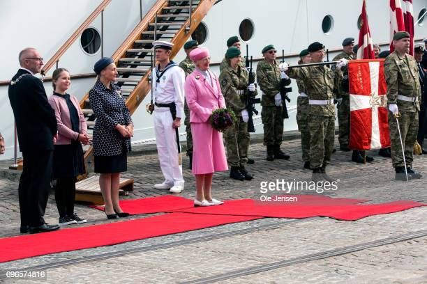 The national anthem is played while Queen Margrethe of Denmark is welcomed at the harbour on June 15 2017 in Hobro Denmark The Queen who arrived...