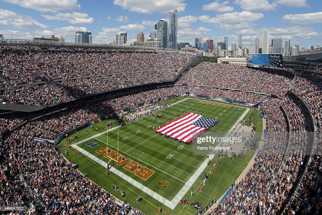 The national anthem is sung as a stealth bomber flies overhead during the pre-game ceremonies of the game between the Chicago Bears and the Green Bay Packers at Soldier Field on September 13, 2015 in Chicago, Illinois.