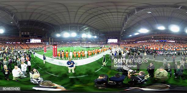 The National Anthem is sung before the 2016 College Football Playoff National Championship Game at University of Phoenix Stadium on January 11 2016...