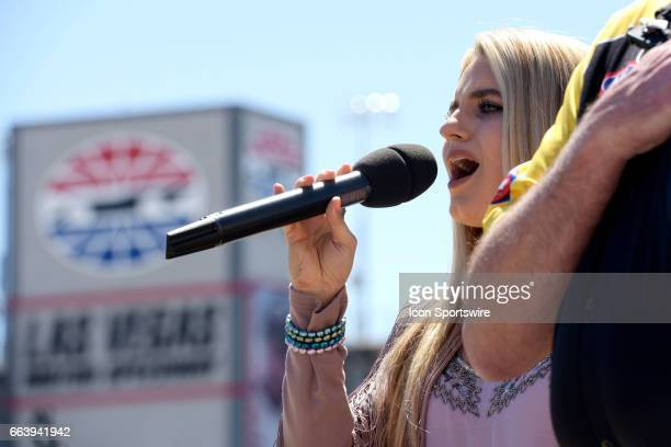 The national anthem is sung by Siena Paglia during the 18th annual DENSO Spark Plugs NHRA Nationals on Sunday April 2 at The Strip at the Las Vegas...