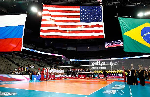 The National Anthem of the United States plays as flags are hoisted after the USA won the gold medal and the FIVB Volleyball World Grand Prix on July...