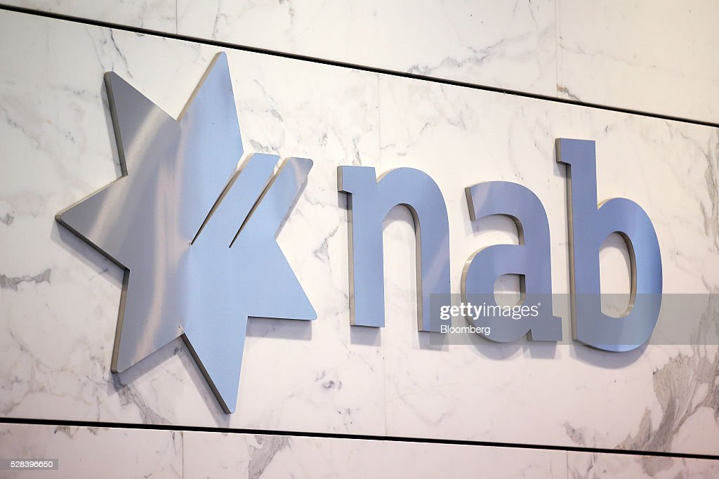 The National Australia Bank Ltd. logo is displayed at the company's offices in Sydney, Australia, on Thursday, May 5, 2016. National Australia posted a 6.5 percent increase in first-half cash profit as it bucked a trend among Australia's largest lenders by decreasing bad-debt charges and as margins improved for the first time since 2011. Photographer: Brendon Thorne/Bloomberg via Getty Images