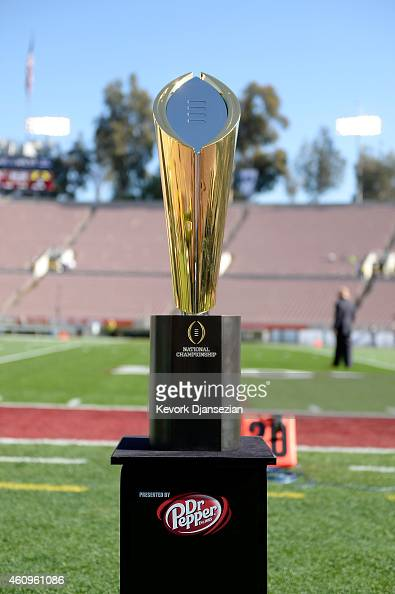 The National Championship Trophy presented by Dr Pepper is seen on the field prior to the College Football Playoff Semifinal at the Rose Bowl Game...