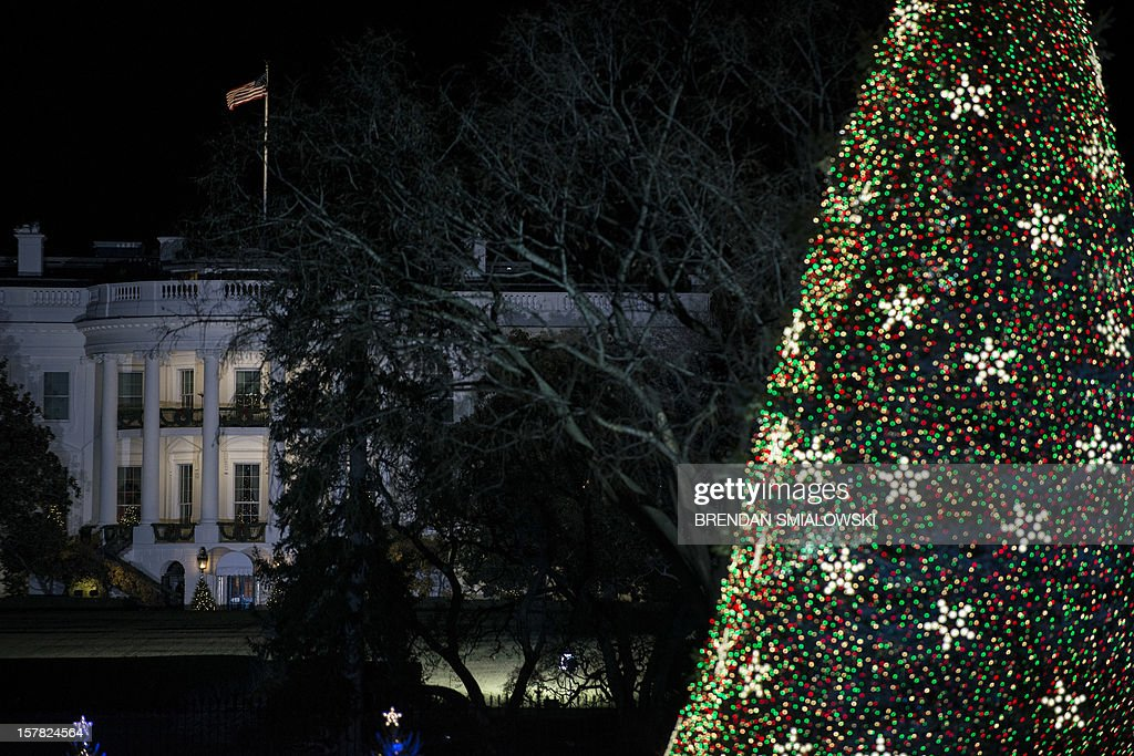 The National Christmas Tree is seen after illumination during the 90th annual National Christmas Tree Lighting on the Ellipse of the National Mall December 6, 2012 in Washington, DC. US President Barack Obama and others attended the event which included entertainment before the lighting of the National Christmas Tree. AFP PHOTO/Brendan SMIALOWSKI