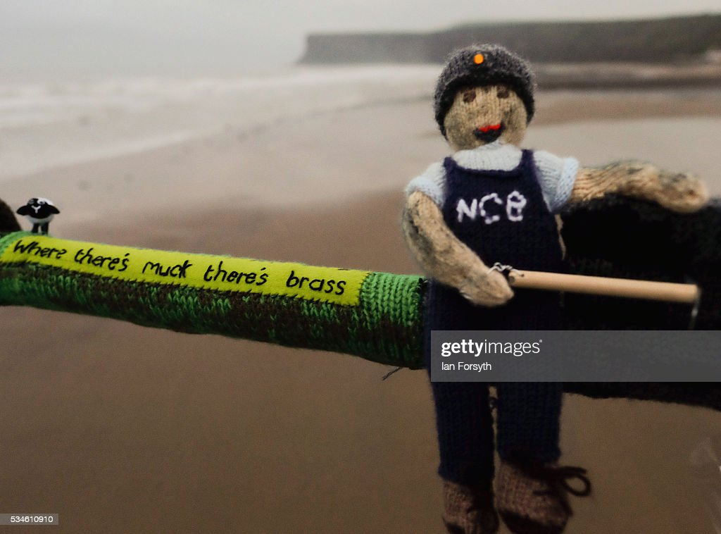 A secretive group of knitters known as the Saltburn Yarn Stormers have left a display of knitting celebrating Yorkshire attached to railings on the Victorian pier on May 27, 2016 in Saltburn-by-the-Sea, England. The group whose identities remain secret attached their latest creations to the pier during the night. This year's theme includes knitted figures, landmarks and phrases that all celebrate the County. The display stretches over 40 meters along the pier and some of the pieces have QR codes attached so visitors can scan them for more information. Previous themes displayed by the group includes the World Cup, the Olympics, the Queen's Jubilee and Alice in Wonderland.